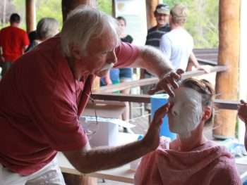 Kim Perrier taking a cast of a local resident's face for the Rising From the Ashes project coordinated by Southern Forests Arts in 2016 at the Painted Tree Gallery in response to the Northcliffe Bushfire 2015