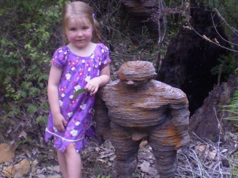 Young girl with 'Forest Folk' sculpture _ Understory Art & Nature trail