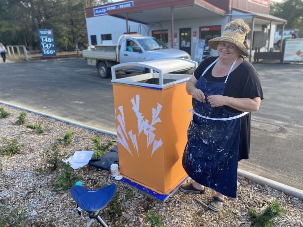 Liz Edmunds working on a Blooming Wild Bin for Northcliffe commissioned by Southern Forest Arts